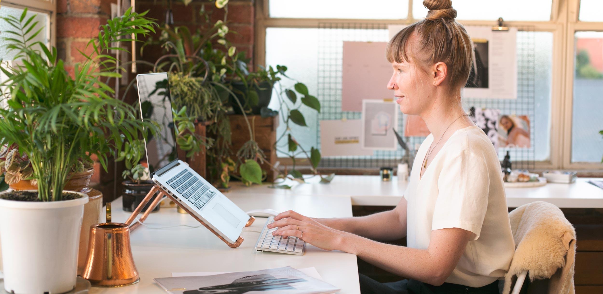 Dani Smiling At Her Computer