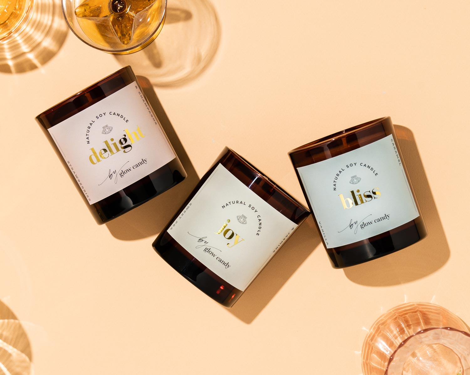 Glow Candy's natural soy candle range. Photographed in a flatly with stunning glass vessels.