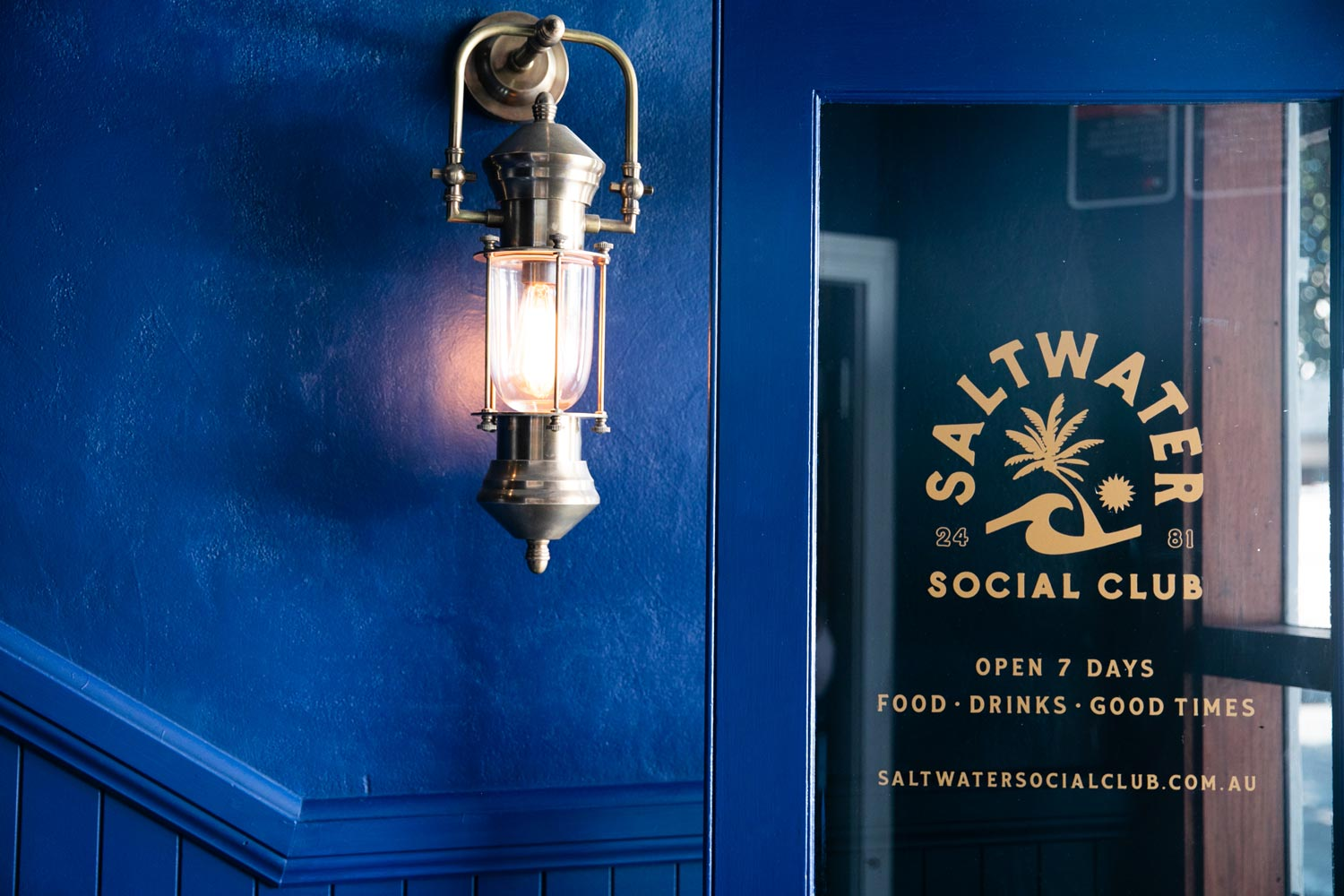 Saltwater Social Club, Exterior Snapshot (Navy door with gold decals)