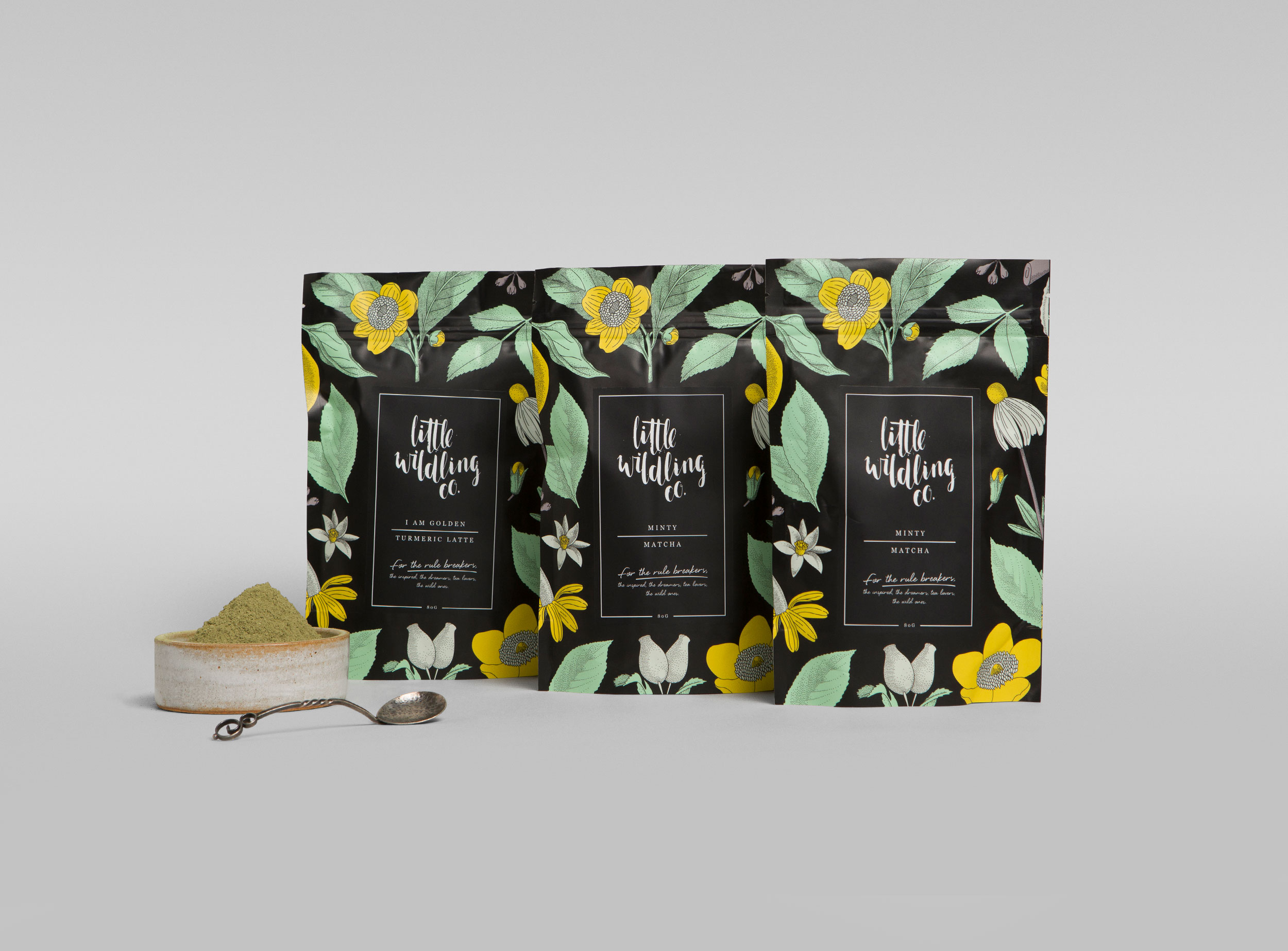 Three bags of Little Wildling Co tea sit side by side. The bags are brightly coloured, because they are from the powdered tea range (matcha powder).